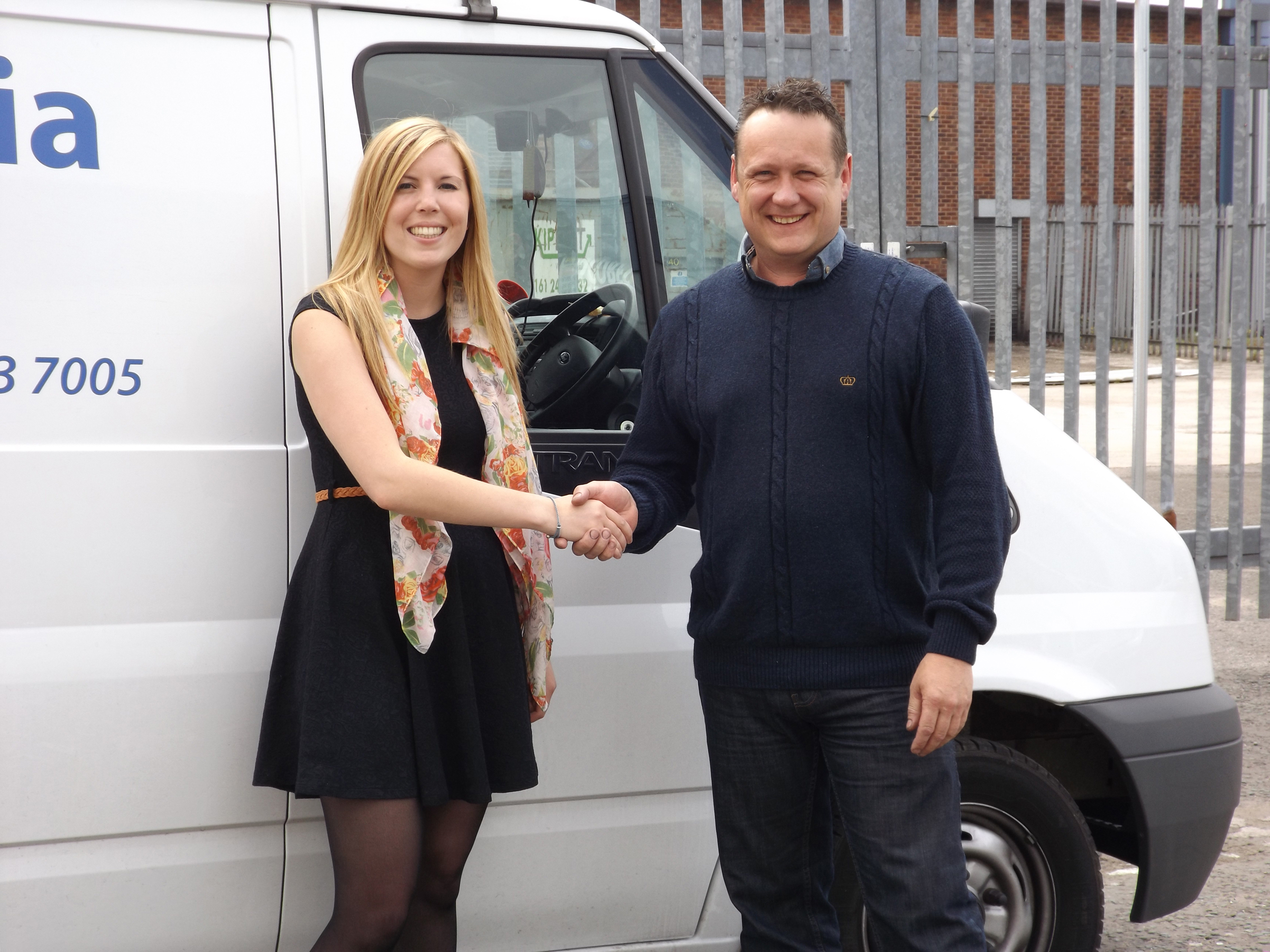Lucy McIntosh, TouchStar Sales Executive, congratulates Tony Jones, Operations Manager at NWMS