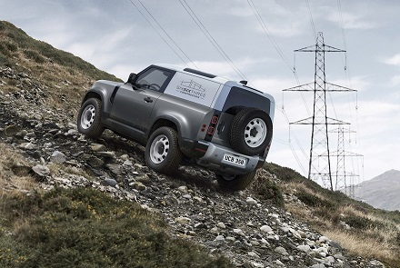 The Land Rover Defender Hard Top 2020 climbs a hill